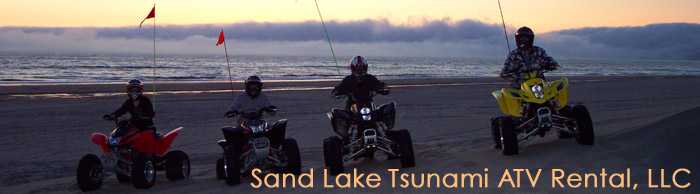 """We posed with this beautifully slow thick fog that blanketed the sunset at the end of our riding day - a nice back drop."" The fog bank rolls south over Cape Lookout, mystifying the Pacific Ocean sunset, just off the beach at Sand Lake Dunes on the Oregon Coast."
